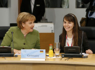 "The G8 President Angela Merkel with ""her"" young delegate"