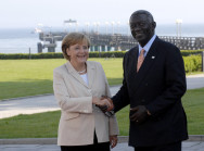 German Chancellor Angela Merkel welcomes John A. Kufuor, President of Ghana, to Heiligendamm